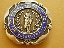More details for vintage silver enamel badge general nursing council england & wales s.r.n. c1927