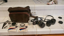 Vintage Yashica FS 7 35mm camera with 3 lenses