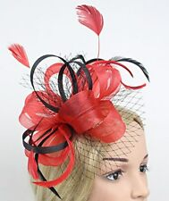 STUNNING RED AND BLACK SINAMAY FASCINATOR WITH NETTING AND MATCHING FEATHERS