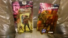 LOT OF TWO 1998 AND 2001 MCFARLANE TOYS FREDDY KRUGER , ONE PACKAGING DAMAGED