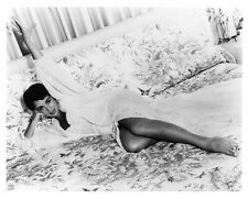 ELIZABETH TAYLOR on bed still - (f155)