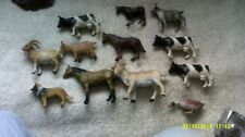 12 various plastic farm yard animals upt0  4in long 3in high