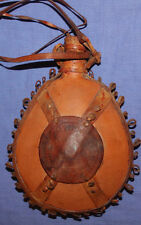 Vintage hand made pottery flask with leather decoration