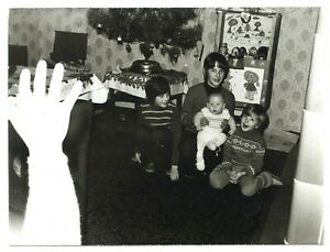 Mistake white waving hand children at Christmas 1979 strange abstract vintage