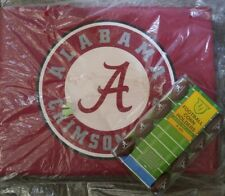 Alabama Crimson Tide seat cushion and corn holders.