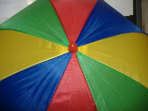 UMBRELLA HAT GREEN,RED,BLUE,YELLOW,  KNOB ON TOP IS RED GOOD IN SUN & RAIN