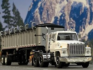 1/64 DCP Ford LN 9000 (White) w/Silver East End Dump w/Black Tarp