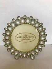 Una FAVOLOSA tondo satinato bianco pietra preziosa e luminosa pendente cristallo cornice fotografica.
