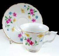 "CHINESE PORCELAIN PINK BLUE AND YELLOW FLORAL PANELED 2 7/8"" CUP AND SAUCER SET"