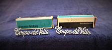1970-80'S CADILLAC COUPE DEVILLE ROOF SCRIPT EMBLEMS OEM NOS (2) METAL #9881196