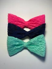 Oversized lace bow hair clip from Claire's, 3 colors: Pink, Navy Blue, and Aqua