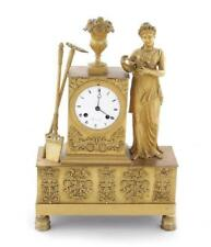 French Neoclassical ormolu figural mantle clock Lot 55