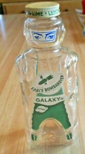 GALAXY VINTAGE LEMON LIME SYRUP BOTTLE, 1950'S SPACE BOMBARDIER ROBOT BANK-NOS