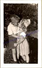 1930s Young Adolescent Boy Hugging & Kissing Curly Blonde Hair Girl Photo