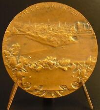 Medaille 1900 vue de l'île Beaulieu à Nantes Femme sur la proue d'1 navire medal