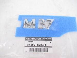Genuine OEM Infiniti 84896-1MA0A 'M37' Rear Trunk Lid Emblem 2011-2013 M37
