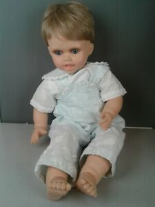 """Lifelike boy doll with baby bibs outfit and white shoes  21"""" long"""