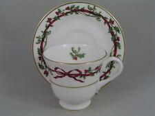 "ROYAL WORCESTER ""HOLLY RIBBONS"" TEA CUP AND SAUCER."