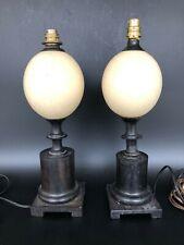 ancienne paire de lampes ébène et œufs d'autruche vers 1950