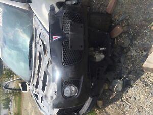 2008 Pontiac solstice gxp front bumper driver side center grille