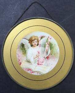 ANTIQUE FLUE COVER OF AN ANGEL