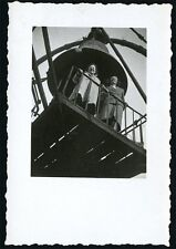 vintage photo women stand on platform under giant bell nice angle  composition