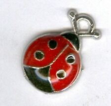 Black and red ladybug alloy charm or pendant.