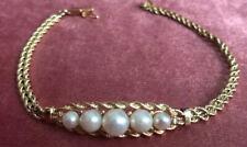 Bracelet en or 18 carats, deux diamants et cinq perles de culture