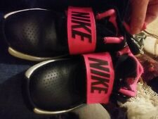 girls pink and black nike tennis shoes Excellent used condition size 13C