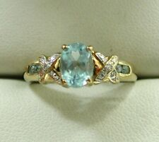 Lovely 9 carat Gold Clue Topaz and Diamond Dress Ring Size R