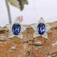 4Ct Oval Cut Tanzanite Push Back Star Halo Stud Earrings 14K White Gold Finish