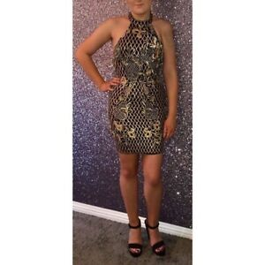 Black and gold halterneck dress. Available in sizes 6-12. True to size.
