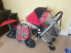 Bugaboo cameleon pushchair and travel set- with red accessories