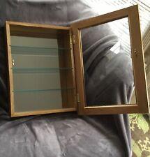 Oak wall cabinet glass shelves mirror backer