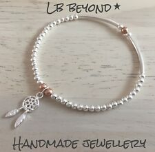STERLING SILVER AND ROSE GOLD BEADED STACKING BRACELET, DREAM CATCHER CHARM