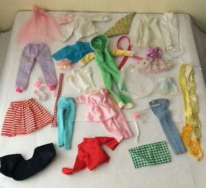 Bundle Lot of vintage dolls clothes may have faults / fading