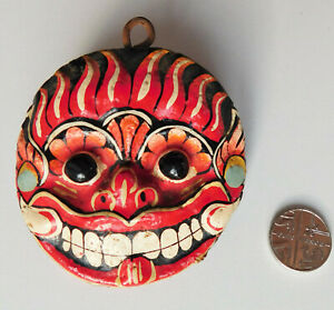Small wooden oriental mask hanging ornament painted wood face 2.5 inches