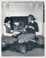 Girls Pop Popcorn by Fireplace Sitting on Bear Skin Rug Press Photo