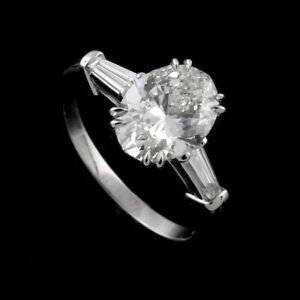 Oval Shape Diamond And Tapered Baguettes Three Stone Engagement Ring Setting