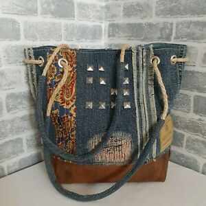 Handmade Hobo denim bag made from recycled jeans and leather in ethnic style