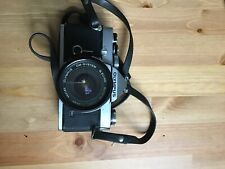 Olympus OM-1 35mm SLR Film Camera with 28 mm lens and leather case