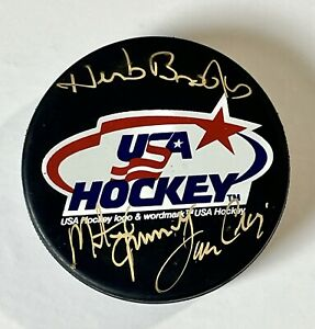 RARE Herb Brooks, Jim Craig, Mike Eruzione Signed 1980 USA Hockey Puck BAS LOA