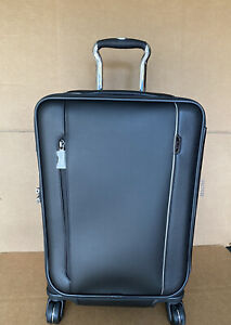 TUMI ARRIVE 3 INTERNATIONAL DUAL ACCESS 4 WHEELED CARRY-ON LEATHER BLACK