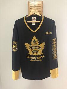 ROOTS Vtg 2002 Salt Lake City TEAM CANADA Olympic GOLD MEDAL Jersey Men (L) NOS