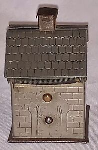 Antique novelty white metal travelling inkwell in the shape of stone building, c
