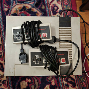 Nintendo Entertainment System Deluxe Gray Console With Two Controllers