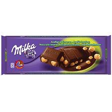 Tablette de 300 gr de chocolat Milka aux noisettes entières, neuf emballé.