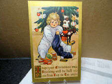 1909 Embossed Postcard Christmas Child With Stocking Full Of Toys Miller