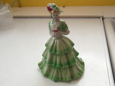 ?VINTAGE CHINA FIGURE OF A LADY IN A TIERED DRESS IN SHADES OF GREEN NO MAKER