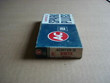 8 VINTAGE NOS AC DELCO R46TX GREEN STRIP SPARK PLUGS IN THE OLD BOX 5613579